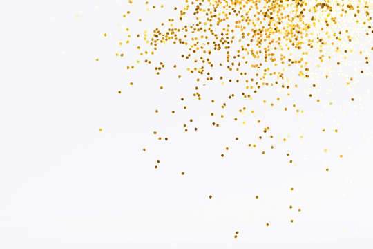 White background with golden glitter. Party background with confetti.