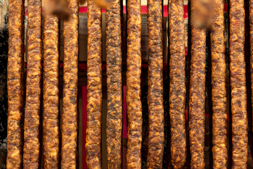 Hanging sausages in smokehouse for sale at the winter Christmas market