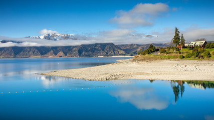 Beautiful view of Lake Hawea with snow capped peaks in a clear winter day, South Island, New Zealand