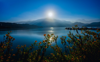 Beautiful flower and sunrise at Sun Moon Lake  ,Taiwan.