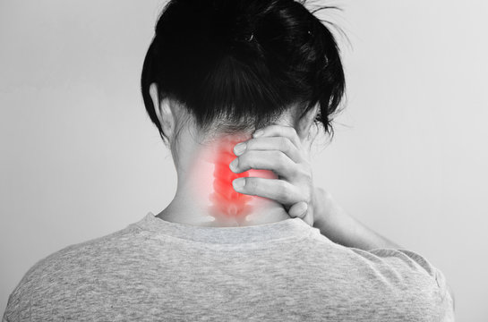 Neck Pain. a man touching neck at pain point