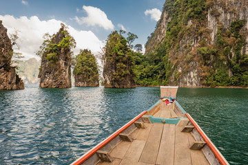 Wooden thai longtail boat on Cheow Lan lake in Khao Sok National Park, Thailand