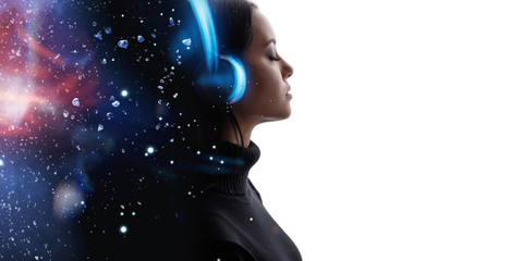 Portrait of woman in headphones listening music with closed eyes. Double exposure of female face and galaxy isolated on white background. Digital art. Blue neon light. Free space for text. Wall mural