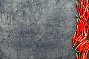 Hot red pepper. Chilean pepper on a black.