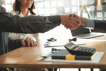couple customer shaking hands with insurance mortgage broker lawyer realtor. client handshaking...