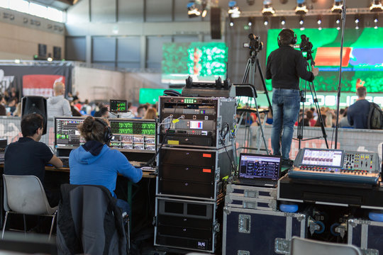 Lighting and Sound Technicians and Television Operators at Work in the BackStage during a Public Event