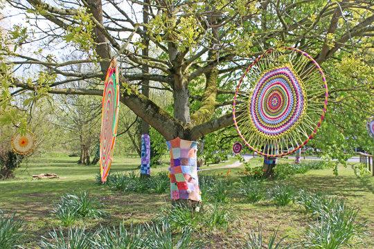 Yarn bomb circles in a park