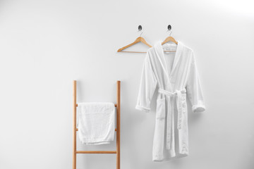 Soft comfortable bathrobe and fresh towel indoors Wall mural