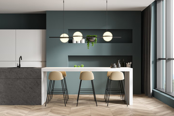 Green and white kitchen interior with bar