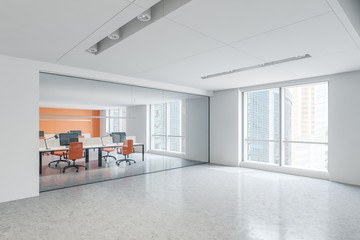 Corner of white and orange open space office