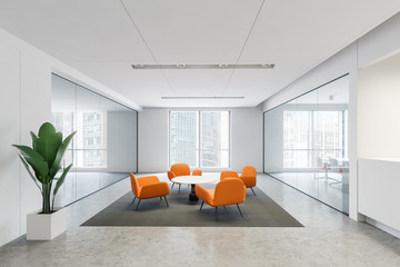 Bright orange armchairs in office waiting room