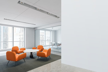 Waiting room with orange armchairs in office