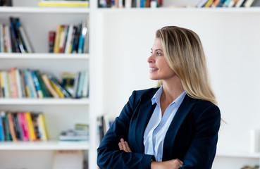 Thinking blond businesswoman with blazer