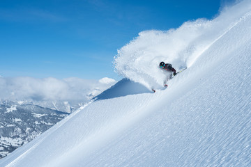 big skier snow spray