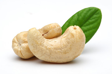 Raw cashew nuts with green leaf isolated