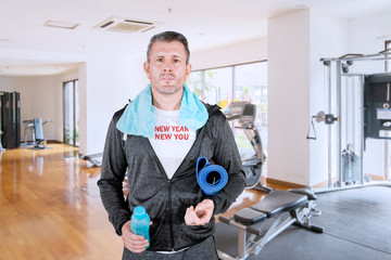 Man staring at camera while wearing jogging outfit