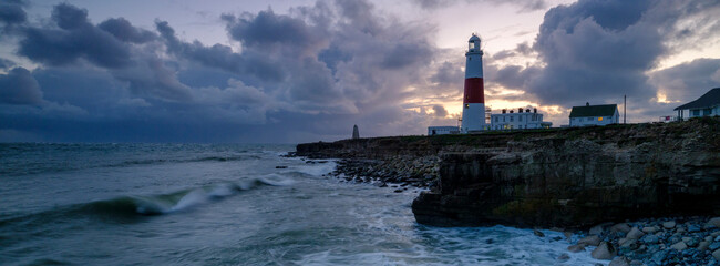 Foto auf AluDibond Insel Portland Bill Light house with a stormy sunset