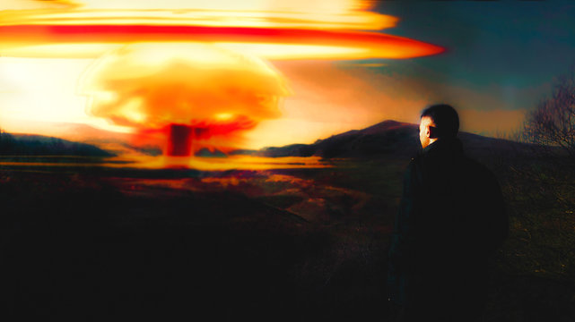 Nuclear explosion. A guy stands and looks.