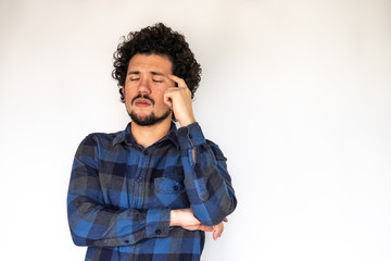 Latin American man, tired expression, neutral background
