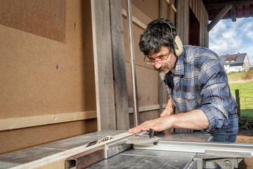 Man at the Circular Saw, Insulating and Paneling an Outside Wall
