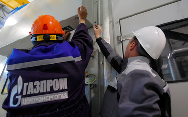 Gazprom employees adjust equipment at the Atamanskaya compressor station, facility of Gazprom's Power Of Siberia gas pipeline outside the far eastern town of Svobodny