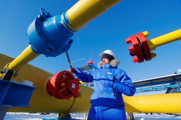 An employee checks a gas valve at the Atamanskaya compressor station, part of Gazprom's Power Of Siberia gas pipeline outside the far eastern town of Svobodny