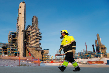 An employee walks past facilities of Amur gas processing plant under construction, part of Gazprom's Power Of Siberia project outside the far eastern town of Svobodny