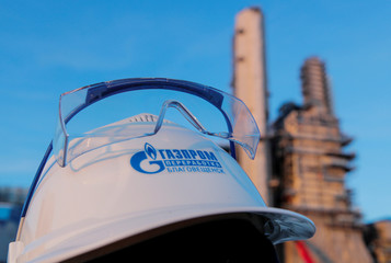 A branded helmet is pictured at the construction site of Amur gas processing plant, part of Gazprom's Power Of Siberia project outside the far eastern town of Svobodny