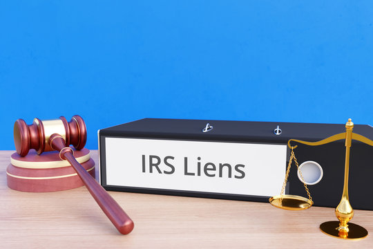 IRS Liens – Folder with labeling, gavel and libra – law, judgement, lawyer
