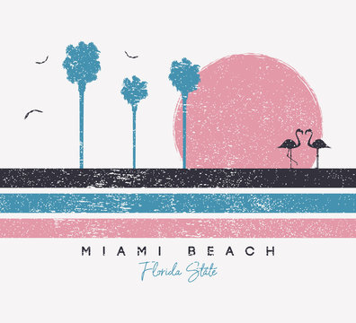 Miami Beach, Florida t-shirt design with flamingo and palm trees. Typography graphics for t shirt with stripes and grunge. Print for apparel. Vector illustration.