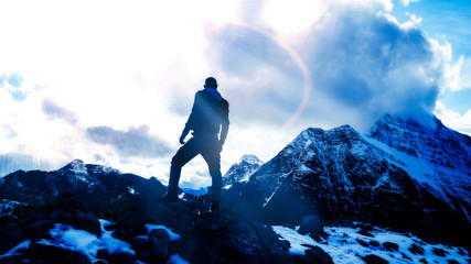 Epic Silhouette of Man Standing On Extreme Mountain Summit