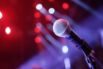 Microphone on stage with lights in background