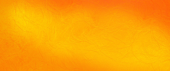 Abstract background texture in colorful orange yellow and gold background in detailed crinkled leather texture illustration, Thanksgiving or halloween autumn colors with shiny metal pattern
