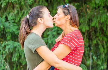 lesbian women couple kissing at the park
