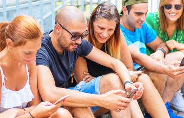 group of friends are watching smart mobile phone