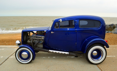 Classic Blue Hot rod  on seafront promenade