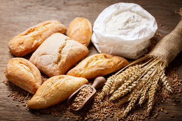 fresh bread with wheat ears, flour and grains