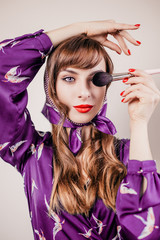 Bright makeup on the face of a girl of the Slavic type - Russian beauty