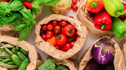 Keuken foto achterwand Keuken Eco vegetables in paper bags on wooden background