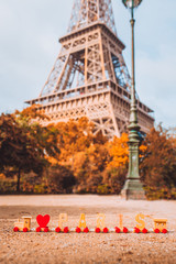 """Wooden letters """"I love Paris"""" on the background of the Eiffel Tower"""