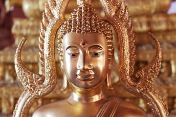 Face image of Golden Buddha statue at Thai temple, Bangkok, Thailand