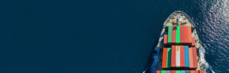 Aerial drone panoramic photo of industrial container tanker cruising in open ocean deep blue sea
