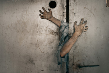 Zombie hands sticking out of the elevator door