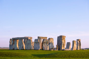 Stonehenge, clear evening sky. Prehistoric monument in Wiltshire, England. Historic Neolithic Stones. No people.
