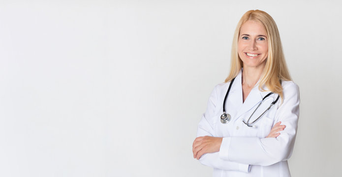Healthcare concept. Middle-aged woman doctor in uniform