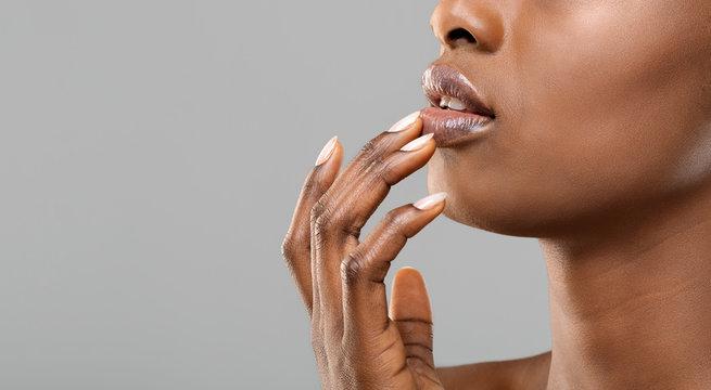 Unrecognizable black woman touching her beautiful plump lips