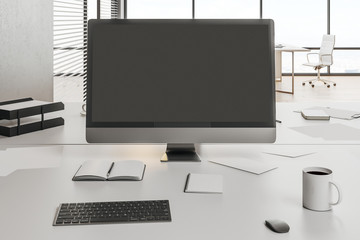 office with blank computer screen