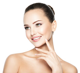 Beautiful face of young cheerful woman with  health fresh skin