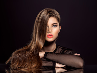 Woman with beauty long brown hair. Beauty woman with living coral color lipstick on lips. Wall mural
