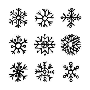Hand drawn snowflakes on white background